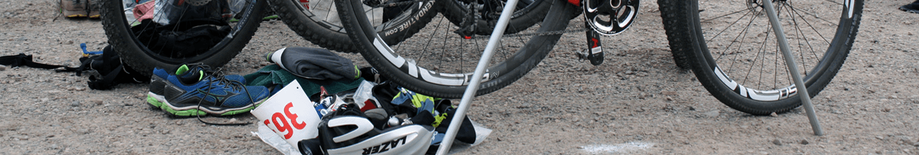 Header image of a bicycle and helmet on the ground during Mountain Man Triathlon