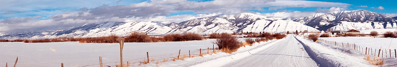 Header image of an empty snowy mountain landscape